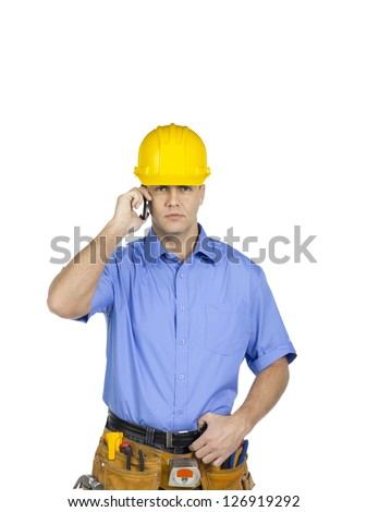 Portrait shot of a construction worker talking on mobile phone
