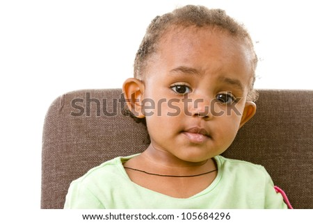 portrait shot of an adorable little girl looking surprised - stock photo