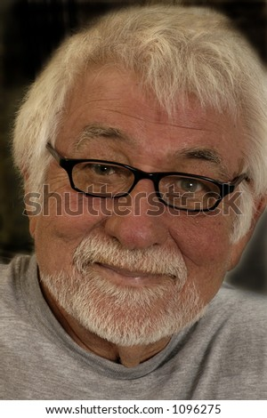 Portrait shot of content older man with glasses - stock photo