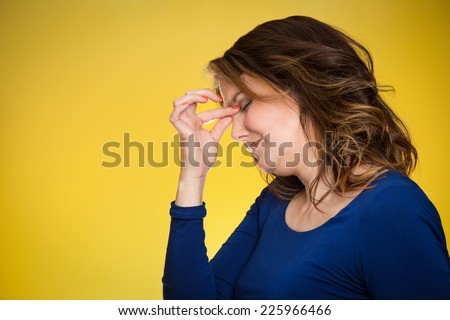 Portrait side view profile headshot of stressed housewife middle aged woman with headache isolated on yellow background. Human face expressions, emotions, feelings, life perception  - stock photo