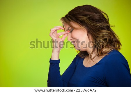 Portrait side view profile headshot of stressed housewife middle aged woman with headache isolated on green background. Human face expressions, emotions, feelings, life perception  - stock photo