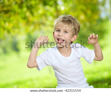 Portrait small the poseurs, grimacing in a summer garden - stock photo