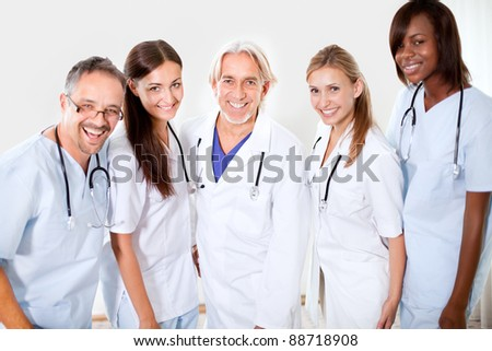 Portrait smiling doctors and colleagues standing together - Smiling at the camera - stock photo