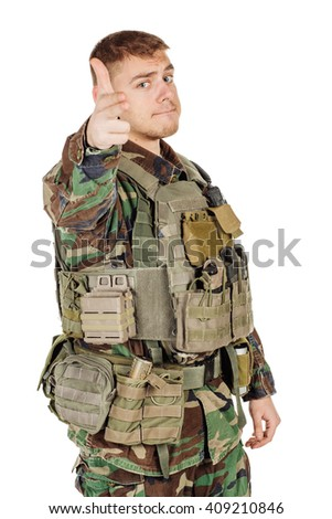 Portrait soldier or private military contractor making pistol gesture from her hands and shooting. war, army, weapon, technology and people concept. Image on a black background. - stock photo