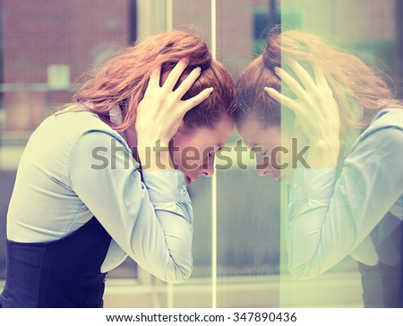 portrait stressed sad young woman outdoors. City urban life style stress - stock photo