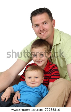 Portrait style image of a young father with his two sons - stock photo
