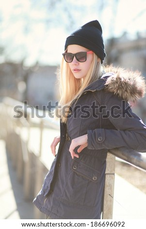 Portrait stylish hipster girl in a warm sunny day, street fashion - stock photo