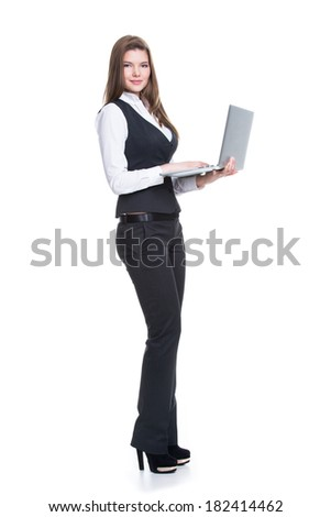 Portrait successful young business woman holding laptop in full length - isolated on white.