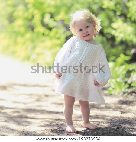 Portrait sunny cute joyful smiling baby in summer day - stock photo