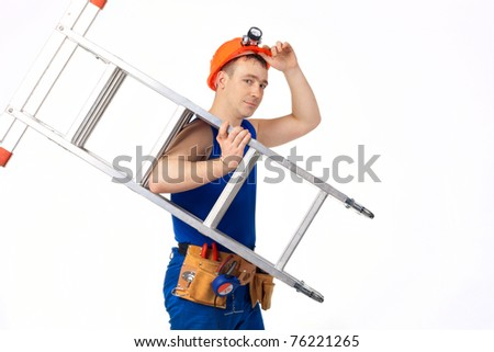 Portrait technician man in work-wear with instrument and step-ladder - stock photo