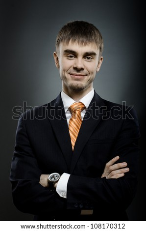 portrait  the  beautiful  businessman careerist in black costume without necktie - stock photo