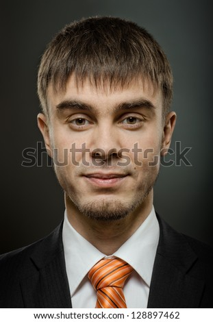 portrait  the  beautiful  businessman  in black costume with tie