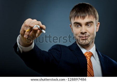 portrait the businessman in costume give up cigarette and  break ,  no smoking - concept