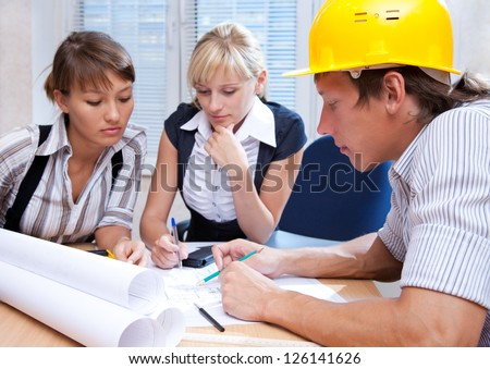 Portrait  the team of engineers working on construction project at the table - stock photo