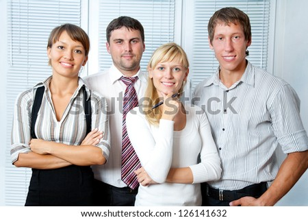 Portrait the young business team at the office - stock photo