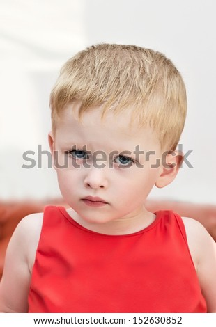 portrait three-year-old kid serious - stock photo