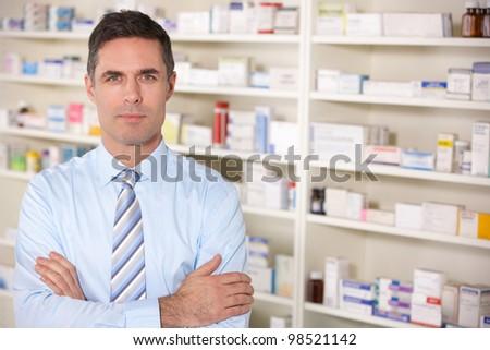 Portrait UK pharmacist at work - stock photo