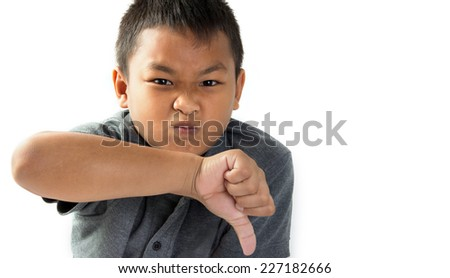 Portrait unhappy, Angry, Displeased Child giving Thumbs Down hand gesture - stock photo