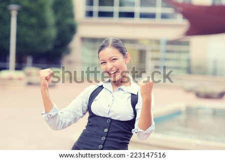 Portrait winning successful young business woman happy ecstatic celebrating being winner victory isolated outside background. Positive human emotion face expression. Life achievement attitude concept - stock photo