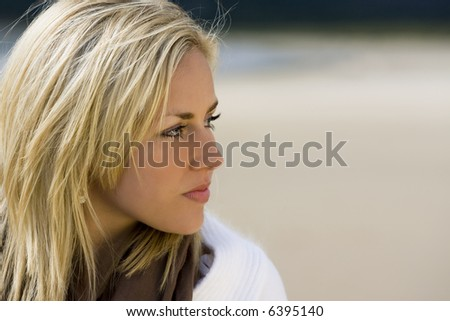 Portrait with copy space of a beautiful young woman at the beach