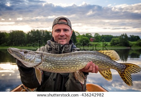 Portrait with huge pike - stock photo