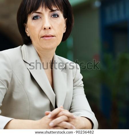 portrait woman brunette sitting glass table - stock photo