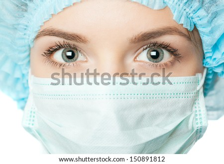 Portrait woman doctor with surgical mask - stock photo