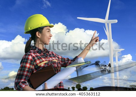portrait women asia engineer working and holding blueprints at wind turbine farm Power Generator Station,Double exposure - stock photo