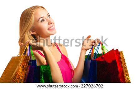 portrait young adult girl with colored bags isolated on white