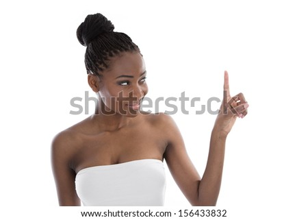 Portrait young African American woman pointing - stock photo