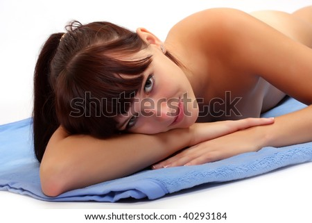 Portrait young attractive girl lying on blue towel - stock photo