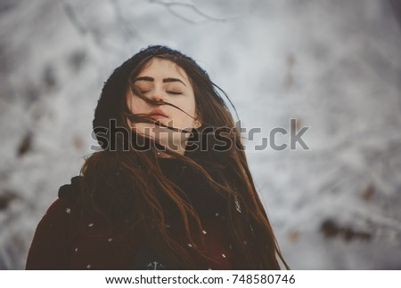 Portrait Young beautiful woman throws snow