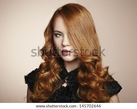 Portrait young beautiful woman with curly hair. Fashion photo