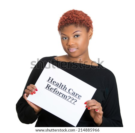 Portrait young confused, skeptical woman holding sign health care reform, hoping for universal health care coverage isolated white background. Government politics, legislation, application in practice - stock photo