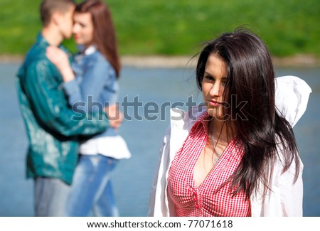 Portrait young girl in a fervent feelings for his girlfriend - stock photo
