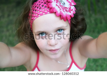 Portrait young girl like she is making picture of herself - stock photo