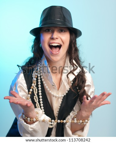 Portrait young happy woman with black leather hat - stock photo