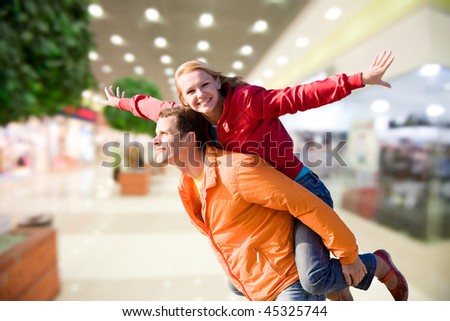 Portrait Young love Couple smiling under interior. - stock photo