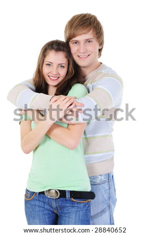 portrait young loving couple with arms round each other - stock photo