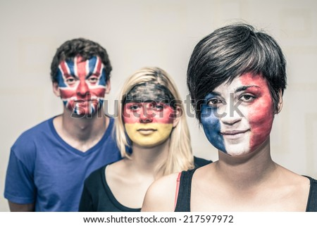 Portrait young people with painted European flags on their faces. - stock photo
