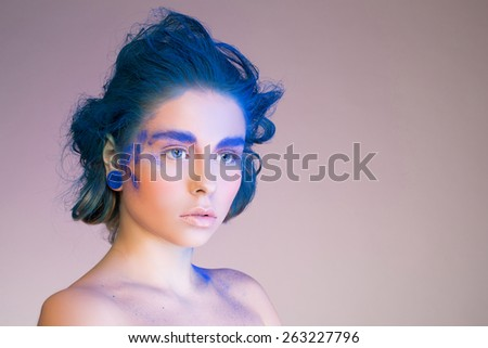 portrait young woman with bright make up and creative hair - stock photo