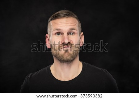Portraite of funny man  on a dark background.