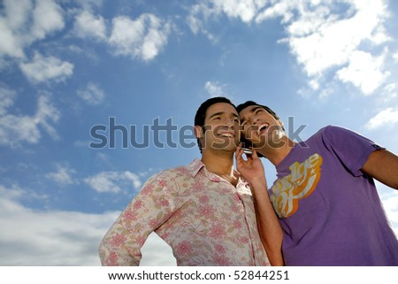 Portraits of two smiling men with a phone
