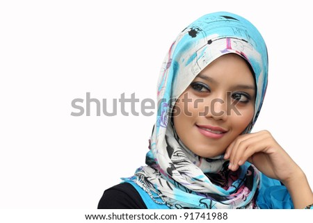 Portraits of young muslim woman smiling over white background - stock photo