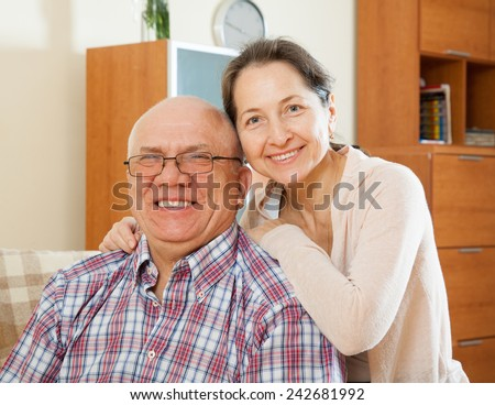 Portreat of beautiful elderly couple on  couch  - stock photo