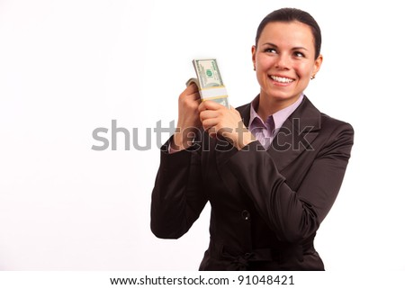 portreit of beautiful business woman with bundle of American dollars on white background - stock photo