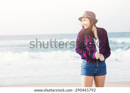 Portrtait of a happy girl enjoying the day on the beach