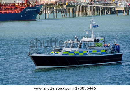 PORTSMOUTH, UK - FEB 22, 2014:  MOD Police Launch Sir Geoffrey Rackham in Portsmouth Harbour.  Portsmouth is the major Naval port in the UK.