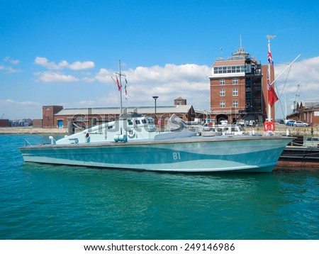 PORTSMOUTH, UK - JUNE 12, 2014: View of Portsmouth historical dockyard on June 12, 2014 in Portsmouth, UK. Historical warships of the UK royal navy are displayed in this landmark dockyard. - stock photo