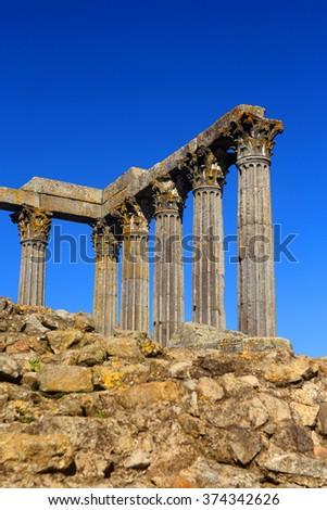 Portugal, Alentejo Region, Evora Historic center. Granite stone columns of Temple of Diana - Roman remains. UNESCO World Heritage site. (selective focus - on columns) Space for text. - stock photo